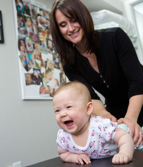 Sarah with laughing baby